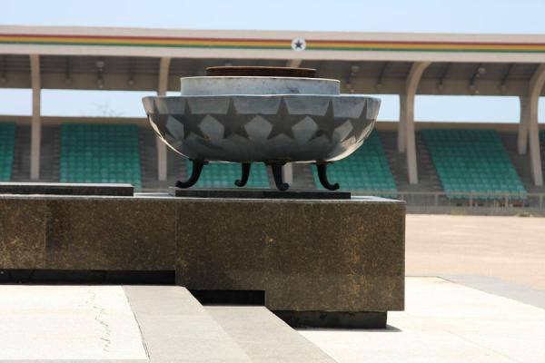 Picture of Independence Square (Ghana): Eternal flame extinguished at Independence Monument with grandstand in the background