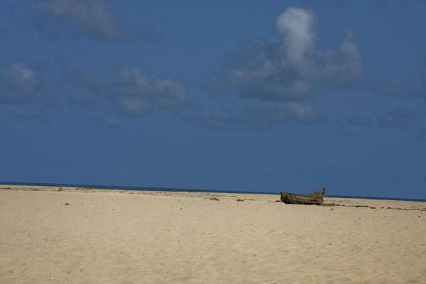 Picture of Ada Foah (Ghana): Lonely boat on a wide beach near the sea at Ada Foah