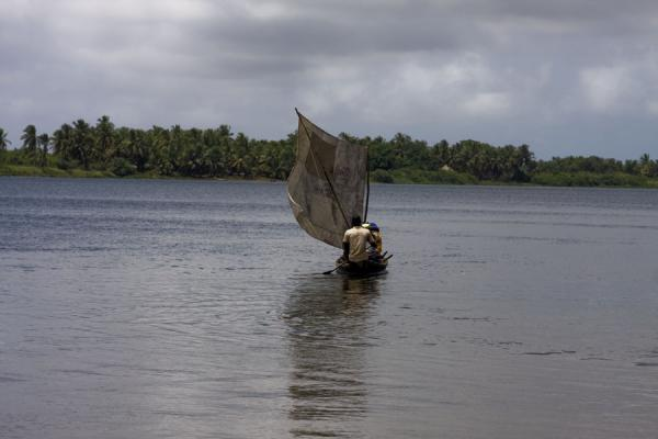 Small sail on a small boat crossing the Volta river | Ada Foah | Ghana