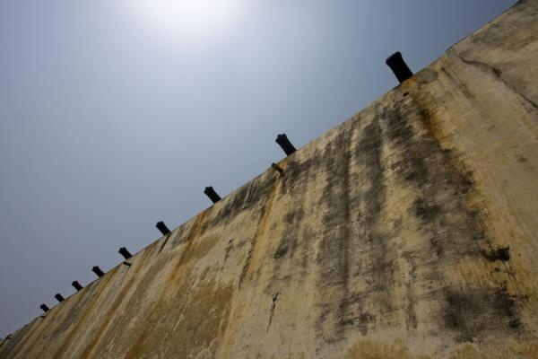 Looking up the wall with cannons of Cape Coast castle | Cape Coast castle | Ghana