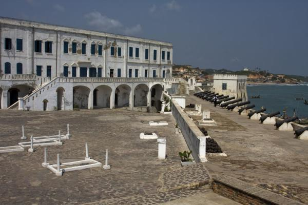 Courtyard of Cape Coast castle with cannons and graves | Cape Coast castle | Ghana