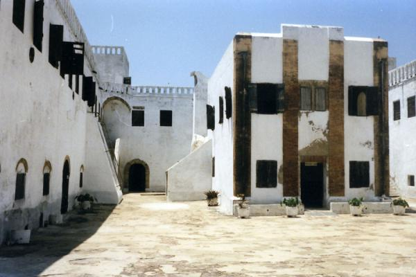 Picture of White buildings and courtyard at Elmina castleElmina Fort - Ghana
