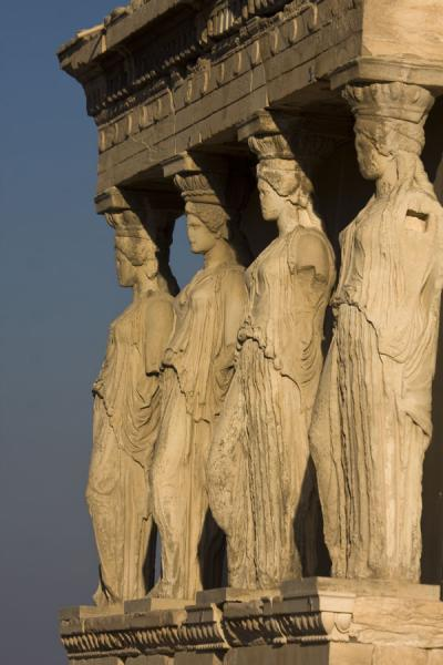 Foto van Caryatids in a row: every maiden statue is uniqueAthene - Griekenland