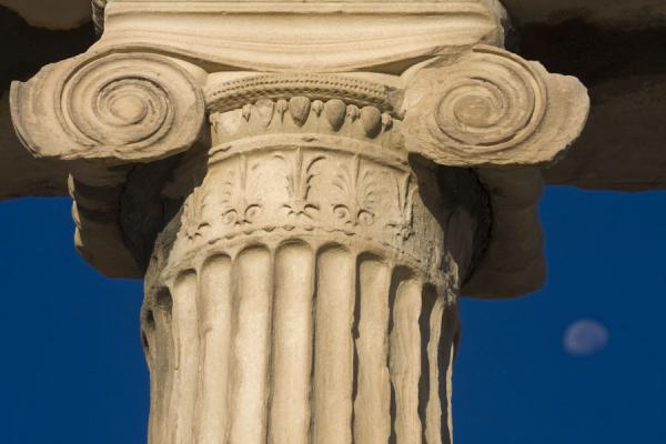 Close-up of Doric column of the Erechteum with moon in the background | Acropolis | Greece
