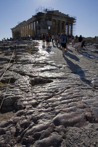 Picture of Parthenon towering over the worn, slippery stones