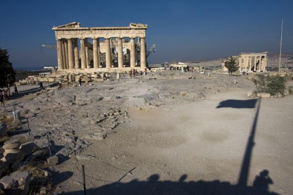 Picture of Looking over the Acropolis plateau from the east, with the Parthenon and a shadow of the Greek flag