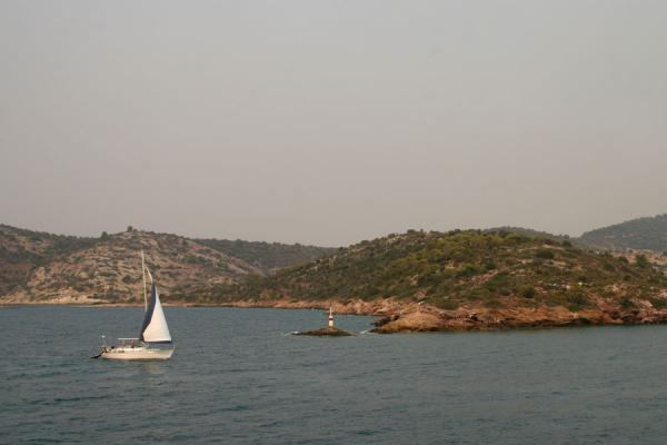 Foto van Sailboat approaching a cape on Poros islandPoros - Griekenland