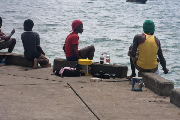 Picture of Grenville (Grenada): Men trying to catch fish from a pier in Grenville