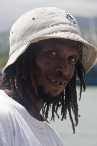 Picture of Grenville (Grenada): Local guy with hat on a pier in Grenville