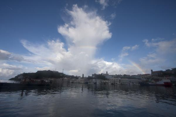 Picture of St. George's (Grenada): Rainbow right over the city of St. George's with the Carenage and inner harbour