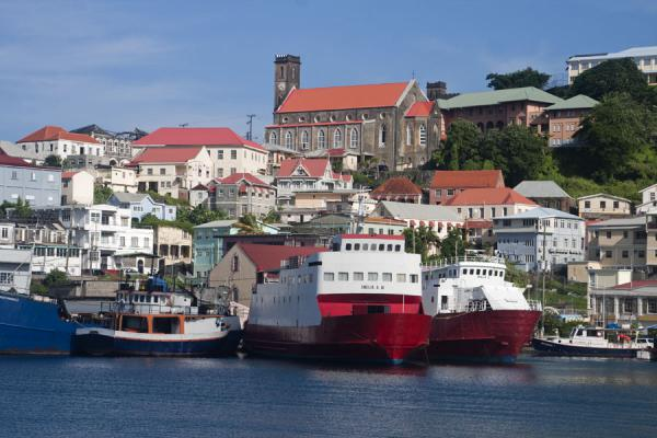 Picture of St. George's (Grenada): Boats docked in the harbour of St. George's with Catholic church on top of the hill