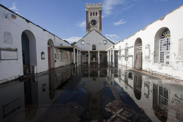 Picture of St. George's (Grenada): Reflection of the bell tower and walls of the Anglican church in the rainwater on the floor