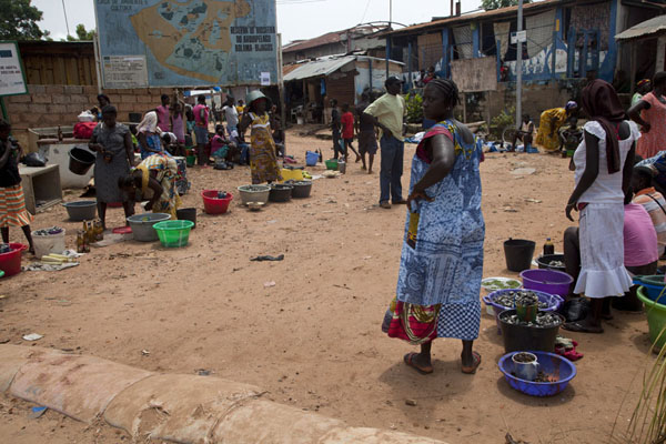 Picture of Departure day at the pier of Bubaque with women selling stuff on the street - Guinea-Bissau - Africa