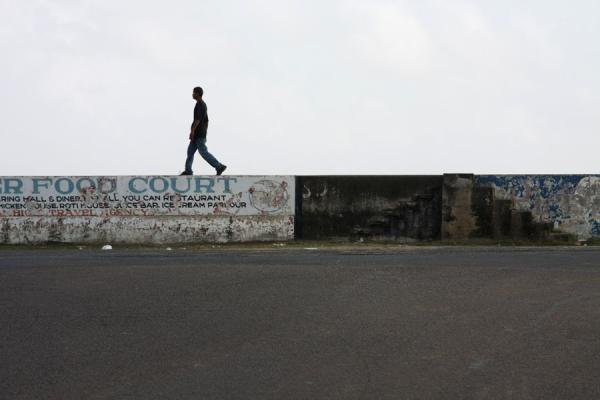 Picture of Georgetown seawall (Guyana): Man walking on the Georgetown seawall
