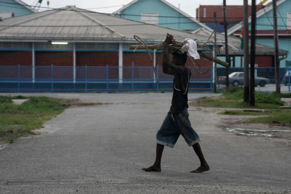 Picture of Georgetown harbour: man carrying wood