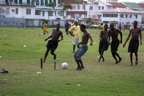 Playing football on a field in Georgetown | Guyanese people | Guyana