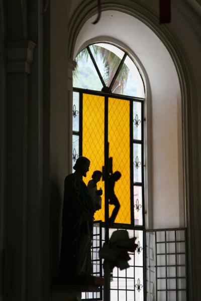 Picture of Cap-Haïtien cathedral (Haiti): Statue and stained glass window in Cap-Haïtien cathedral