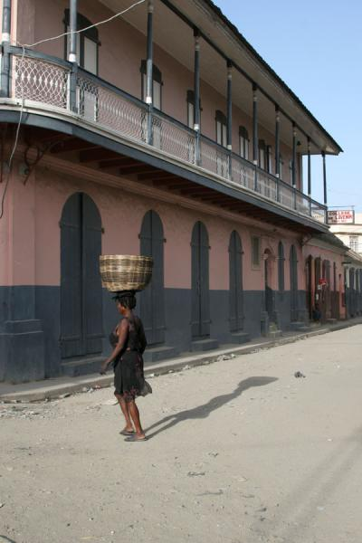 Picture of Woman with basket crossing a street in Cap Haïtien - Haiti - Americas
