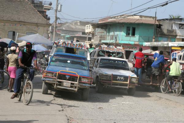 Picture of Cyclist and tap-taps are part of chaotic Cap Haïtien traffic - Haiti - Americas