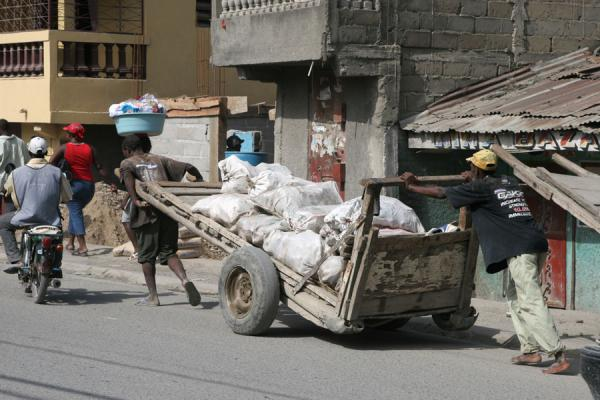 Two men pushing a cart through the streets of Cap Haïtien | Cap Haitïen streetlife | Haiti