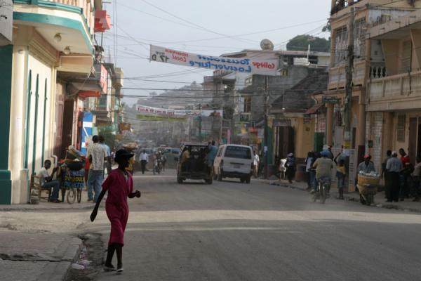 Picture of Woman about to cross a main street in Cap HaïtienCap Haïtien - Haiti
