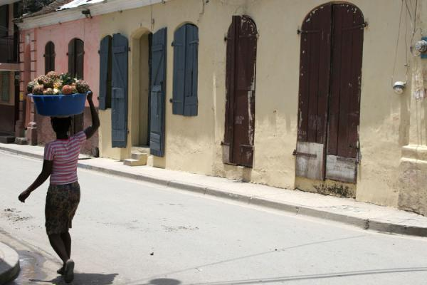 Picture of Cap Haïtien street sellers (Haiti): Pineapple seller in the streets of Cap Haïtien