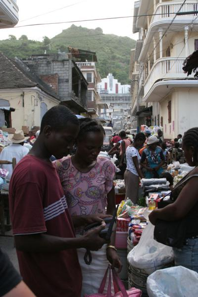 Picture of Cap Haïtien street sellers (Haiti): Making a phone call from the streets using a phone boy