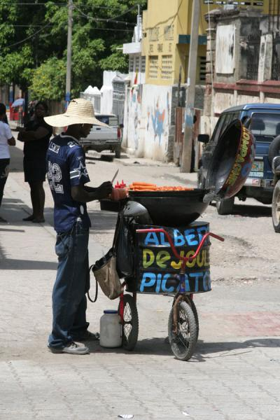 Picture of Cap Haïtien street sellers (Haiti): Food seller on the main square of Cap Haïtien