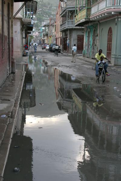 Picture of Flooded street with cyclist in Cap-Haïtien