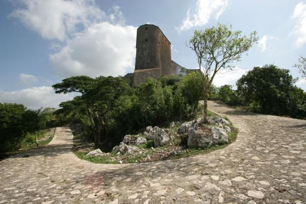 Picture of Citadelle La Ferrière (Haiti): Citadelle la Ferrière looming over the footpath leading up to it