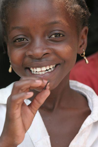 Picture of Haitian people (Haiti): Smiling girl posing for a picture