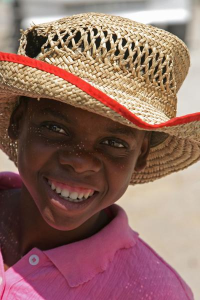 Boy with straw hat near the border with the Dominican Republic | Haitian people | Haiti