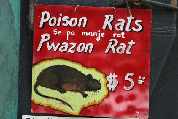 Picture of Haitian signs (Haiti): Advertisement for rat poison on the wall of a shop