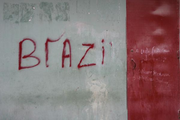 Picture of Haitians expressing their support of the Brazilian football team on the wall