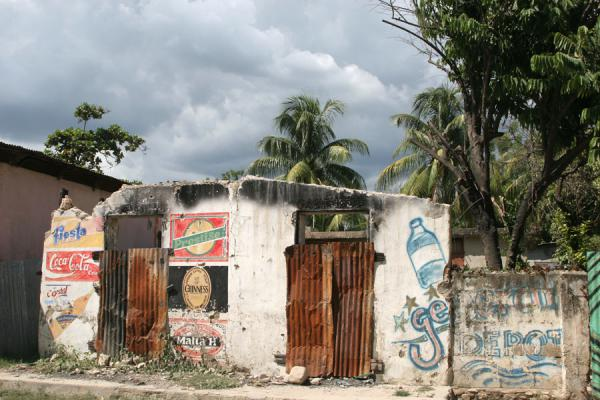 Picture of Haitian signs (Haiti): Bar advertising various brands of drinks on its wall