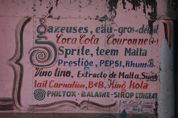 Picture of Haitian signs (Haiti): Selling spirits, water, beer and soft drinks, but also mosquito coils