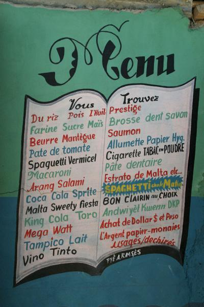 Menu painted on a restaurant wall | Haitian signs | Haiti