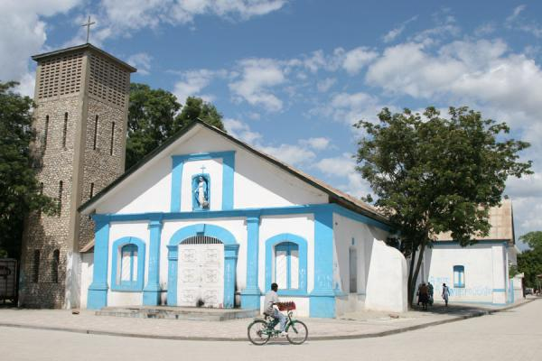 Picture of Hinche (Haiti): Church and cyclist in Hinche