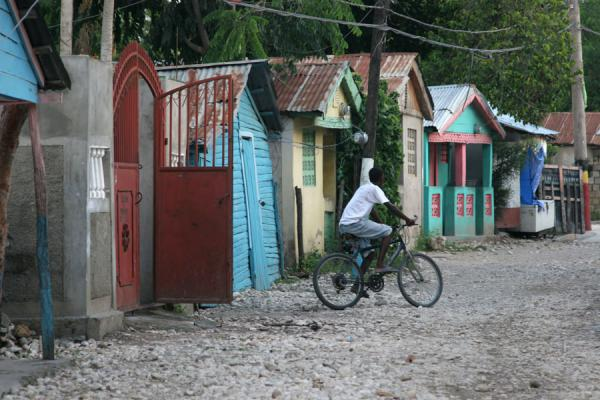 Picture of Hinche (Haiti): Street of Hinche with cyclist