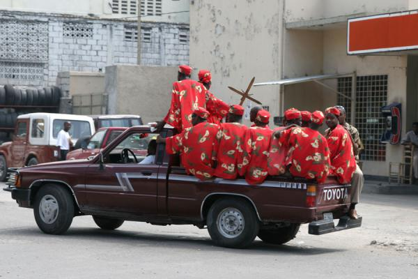 Picture of Port-au-Prince (Haiti): Dressed in red: on the way to religious ceremony in Port-au-Prince