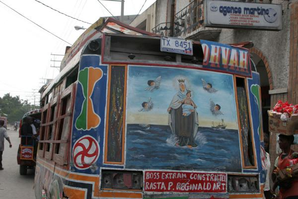 Tap-tap with religious illustration in the streets of Port-au-Prince | Tap-taps | Haiti