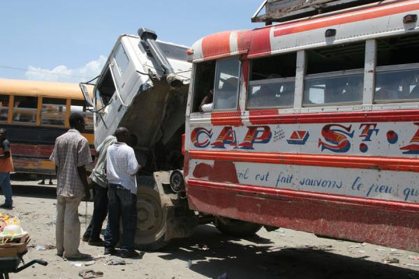 Picture of Tap-taps (Haiti): Bus connected to truck at the bus station of Cap Haïtien