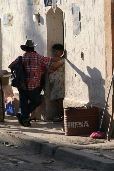 Picture of Western Honduras: chatting street scene in the late afternoon