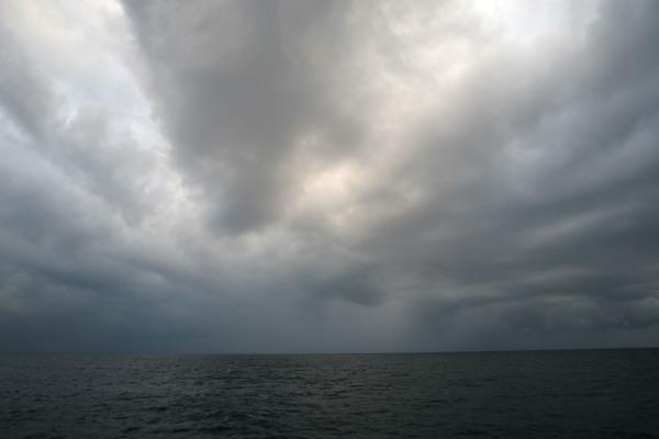 Picture of Honduran Skies (Honduras): Utila: threatening clouds over the sea