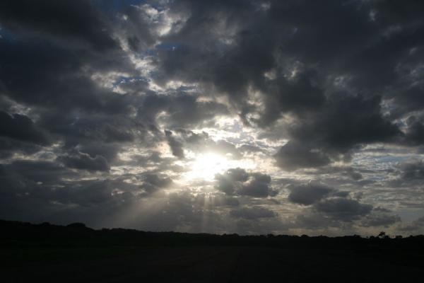 Picture of Honduran Skies (Honduras): Utila: sun breaking through clouds
