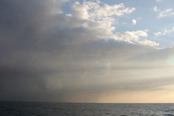 Picture of Honduran Skies (Honduras): Utila: sunlight and clouds over the sea
