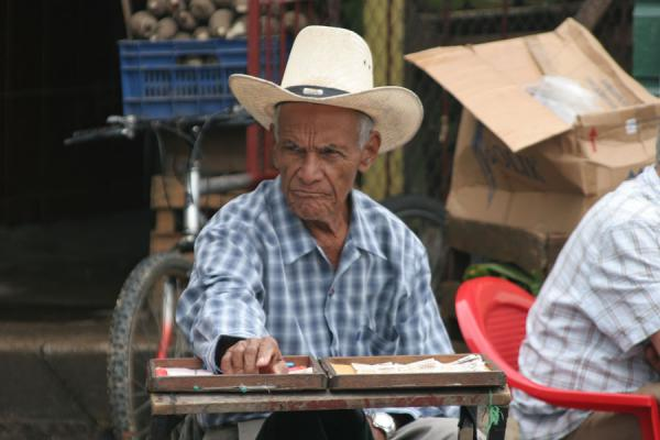 Selling lottery tickets at La Ceiba's market | La Ceiba | Honduras