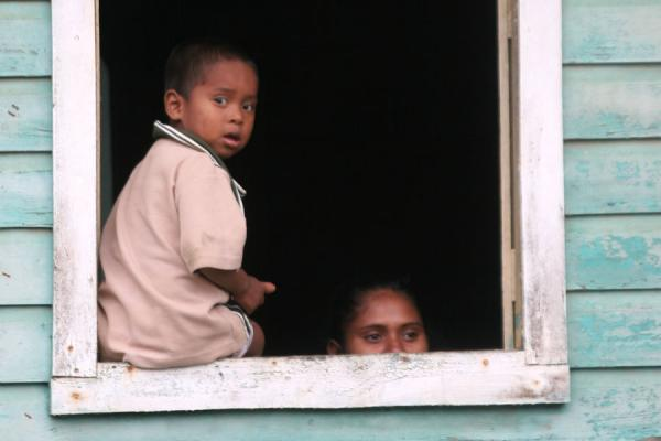 Picture of Limón (Honduras): Limón: locals looking out of a window