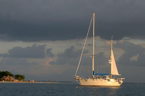 Yacht in the afternoon sun off the Utila coast | Utila | Honduras
