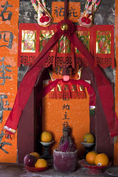 Orange and red are dominant colours in this decoration in Tung Kok Wai | Lung Yeuk Tau Heritage Trail | Hong Kong